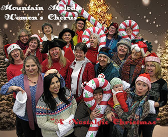 """Mountain Melody Women's Chorus group photo with Christmas decorations and program titled """"A Nostalgic Christmas"""""""