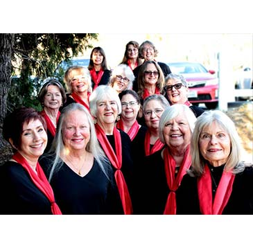 Mountain Melody Chorus group photo wearing black top and red scarf