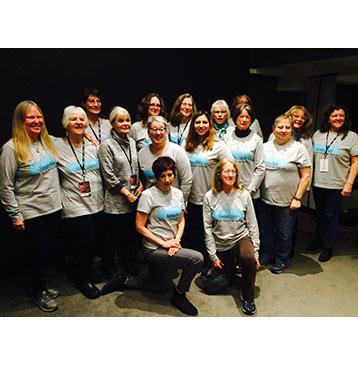Mountain Melody Chorus group photo wearing tee shirts